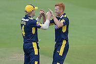 Hampshire pace bowler Ryan Stevenson (L) and Hampshire batsman Jimmy Adams celebrate the wicket of Nick Browne during the Royal London One Day Cup match between Hampshire County Cricket Club and Essex County Cricket Club at the Ageas Bowl, Southampton, United Kingdom on 5 June 2016. Photo by David Vokes.