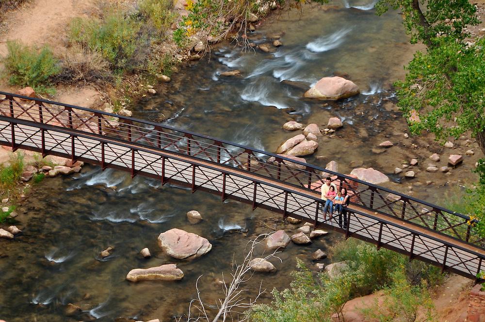 Tourists on footbridge over the Virgin River, Zion Canyon, Utah.