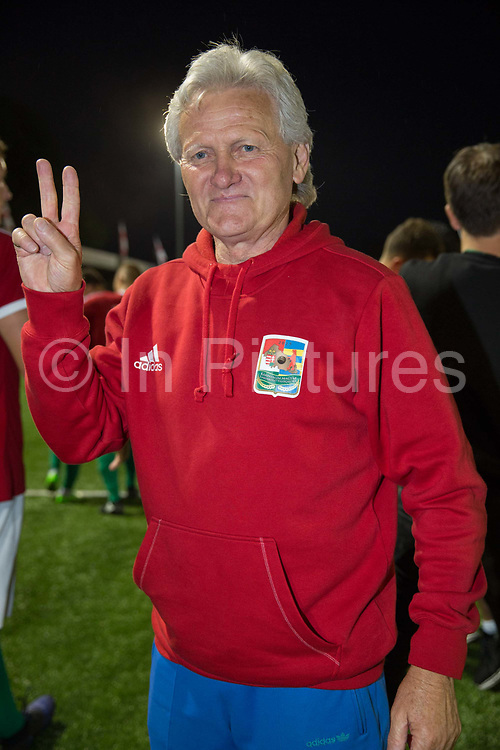 Karpatalya head coach Sandor Istvan celebrates following a 4 -2 victory for Karpatalya red against Szekely Land blue during the Conifa Paddy Power World Football Cup semi finals on the 7th June 2018 at Carshalton Athletic Football Club in the United Kingdom. The CONIFA World Football Cup is an international football tournament organised by CONIFA, an umbrella association for states, minorities, stateless peoples and regions unaffiliated with FIFA.