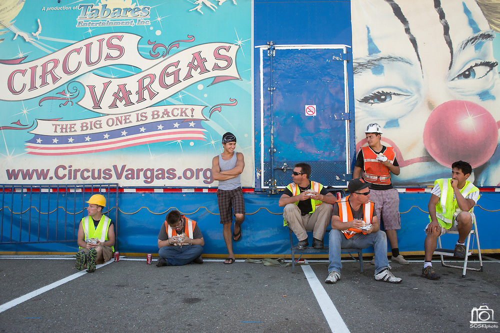 Members of Circus Vargas eat Chipotle burritos on a lunch break while preparing for a weekend worth of performances at the Great Mall in Milpitas, Calif., on Aug. 28, 2012.  Photo by Stan Olszewski/SOSKIphoto.
