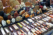 Marble, carved chops for sale in the indoor antique market in Yu Yuan Garden, downtown Shanghai, China. The pots and ceramics being sold by this family business on the top floor of the market are not genuine antiques. Many are fakes, which are sold to the more gullible tourists. Genuine antiques can be bought but the prices reflect their age considerably.