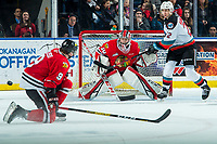 KELOWNA, BC - FEBRUARY 8: Dillon Hamaliuk #22 of the Kelowna Rockets awaits the rebound as Lane Gilliss #9 blocks a shot on Joel Hofer #30 of the Portland Winterhawks at Prospera Place on February 8, 2020 in Kelowna, Canada. Hofer was selected in the 2018 NHL entry draft by the St. Louis Blues and is a IIHF World Junior Championship gold medalist. Hamaliuk was selected in the 2019 NHL entry draft by the San Jose Sharks. (Photo by Marissa Baecker/Shoot the Breeze)