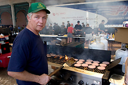 10 Sept 2005. New Orleans, Louisiana. Hurricane Katrina aftermath. <br /> The Turner foundation serves up hot food to anyone who cares to wait in line outside Harrah's casino on Canal Street. Cooking non stop for almost a week, Allen Foley keeps emergency services and the hungry fed.<br /> Photo; ©Charlie Varley/varleypix.com