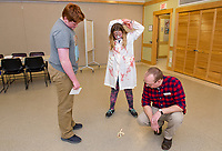Andrew Decker, Delaney Sleeper and John Locke try to see what letter their apple peel spells when thrown over their left shoulder during the tween teen Halloween party at the Meredith Community Center on Tuesday afternoon.  (Karen Bobotas/for the Laconia Daily Sun)