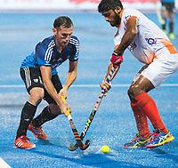 BHUBANESWAR -  Hockey World League finals , Semi Final . Argentina v India. Lucas Vila (Arg) with Varun Kumar (Ind)   COPYRIGHT KOEN SUYK