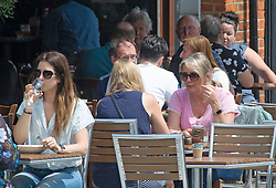 © Licensed to London News Pictures 11/06/2021. Sidcup, UK. A warm cloudy humid day in London as people enjoy eating outside in Sidcup High Street due to Covid restrictions. Temperatures across the UK are forecast to be hotter than Portugal at the weekend with Monday set to be the hottest. Photo credit:Grant Falvey/LNP