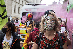 Dr Gail Bradbrook, co-founder of Extinction Rebellion, joins fellow climate activists at a 'Carnival of Corruption' protest against the government's facilitation and funding of the fossil fuel industry on 3 September 2020 in London, United Kingdom. Extinction Rebellion activists are attending a series of September Rebellion protests around the UK to call on politicians to back the Climate and Ecological Emergency Bill (CEE Bill) which requires, among other measures, a serious plan to deal with the UK's share of emissions and to halt critical rises in global temperatures and for ordinary people to be involved in future environmental planning by means of a Citizens' Assembly.