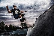 USA, Oregon, Eugene, skater doing a stunt in a skate park. MR