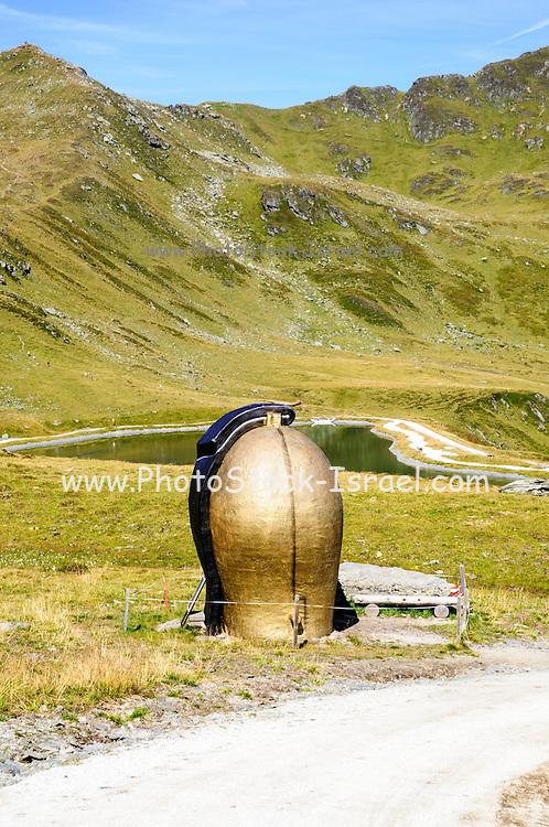 Yodel Hiking Trail first station, giant cow bell.  Konigsleiten mountain top. Zillertal, Tyrol, Austria
