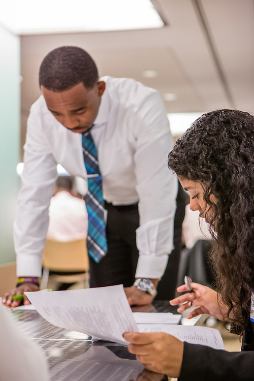 Purchase, NY – 31 October 2014. Lincoln High School team member Paola Ferreira, right, goes over her case notes while Morgan Stanley facilitator Ahkiel White reviews his. The Business Skills Olympics was founded by the African American Men of Westchester, is sponsored and facilitated by Morgan Stanley, and is open to high school teams in Westchester County.