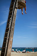 A beach lifeguard on duty at the beach in Barcelona, Spain.