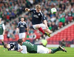 Falkirk's Stephen Kingsley over Hibernian's Tim Clancy..Hibernian 4 v 3 Falkirk, William Hill Scottish Cup Semi Final, Hampden Park..©Michael Schofield..