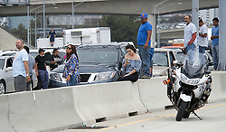 June 30, 2017 - Irvine, CA, USA - Southbound travelers stopped in traffic have to wait to continue their day after a small plane crashes on I-405 freeway at MacArthur in Irvine, CA, missing the runway at John Wayne Airport, injuries are unknown Friday, June 30, 2017. (Credit Image: © Ken Steinhardt/The Orange County Register via ZUMA Wire)