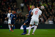 Lewis Dunk of England keeps Bobby Wood of USA off the ball during the International Friendly match between England and USA at Wembley Stadium, London, England on 15 November 2018.