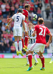 Claudio Yacob of West Bromwich Albion and Christian Stuani of Middlesbrough compete in the air - Rogan Thomson/JMP - 28/08/2016 - FOOTBALL - The Hawthornes - West Bromwich, England - West Bromwich Albion v Middlesbrough - Premier League.