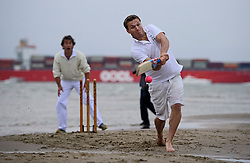 © Licensed to London News Pictures. 18/09/2016. Portsmouth, UK. Teams take part in the  Bramble Bank Cricket Match in the middle of The Solent strait on September 18, 2016. The annual cricket match between the Royal Southern Yacht Club and The Island Sailing Club, takes place on a sandbank which appears for 30 minutes at lowest tide. The game lasts until the tide returns. Photo credit: Ben Cawthra/LNP