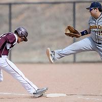 Ganado Hornet Travis Davis (12) jumps back to first base ahead of Joseph City Wildcat Dylan Romero (15) Thursday at Ganado High School.