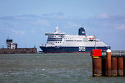 A DFDS Seaway ferry arrives into the Eastern Dock of the Port of Dover where the cross channel port is situated with ferries departing here to go to Calais in France, on the 13th of May 2020 in Dover, Kent, United Kingdom. Dover is the nearest port to France with just 34 kilometres 21 miles between them. It is one of the busiest ports in the world. As well as freight container ships it is also the main port for P&O and DFDS Seaways ferries.