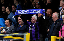 A Bristol Rovers fan holds up a scarf - Photo mandatory by-line: Dougie Allward/JMP - Mobile: 07966 386802 26/04/2014 - SPORT - FOOTBALL - High Wycombe - Adams Park - Wycombe Wanderers v Bristol Rovers - Sky Bet League Two