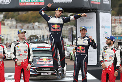 Sebastien Ogier and his co pilot Julien Ingrassia celebrate their victory during day four of the DayInsure Wales Rally GB.