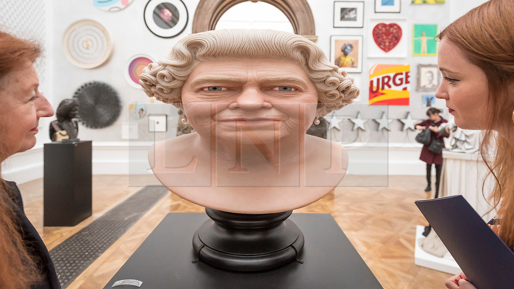 """© Licensed to London News Pictures. 05/06/2018. LONDON, UK. Visitors view """"The Queen"""" by John Humphreys at a preview of the 250th Summer Exhibition at the Royal Academy of Arts in Piccadilly, which has been co-ordinated by Grayson Perry RA this year.  Running concurrently, is The Great Spectacle, featuring highlights from the past 250 years.  Both shows run 12 June to 19 August 2018.  Photo credit: Stephen Chung/LNP"""
