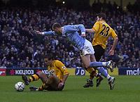 Photo. Glyn Thomas,Digitalsport<br /> Manchester City v Blackburn Rovers. Premiership. <br /> City of Manchester Stadium, Manchester. 17/01/2004.<br /> Man City's Antoine Sibierski (C) is brought down by Brett Emerton (R) and Lucas Neill.
