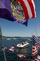 Looking out from the SS Minnow operated by Steve Nix with dozens of boats congregating for the 4th of July boat parade with the Winnipesaukee Yacht Club on Monday morning.  (Karen Bobotas/for the Laconia Daily Sun)