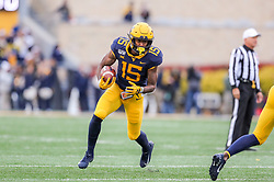 Nov 23, 2019; Morgantown, WV, USA; West Virginia Mountaineers wide receiver George Campbell (15) catches a pass and runs for extra yards during the third quarter against the Oklahoma State Cowboys at Mountaineer Field at Milan Puskar Stadium. Mandatory Credit: Ben Queen-USA TODAY Sports