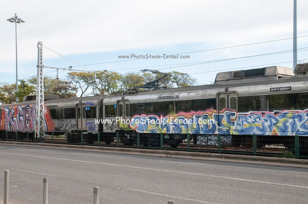 Graffiti painted on a train. Photographed in Belem, Lisbon train station, Portugal
