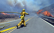 August 16, 2016 - Rancho Cucamonga, California, U.S. - <br /> <br /> Firefighters battle a the Blue Cut Fire in the Cajon Pass Tuesday. The fire scorched at least 6,500 acres of land and forced tens of thousands of people to evacuate as several structures burned. <br /> ©Exclusivepix Media