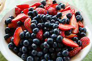 Bowl of fruit (strawberries and blueberries), California