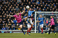 Queens Park Rangers Midfielder, Ryan Manning (14) and Portsmouth Midfielder, Louis Dennis (18) challenge for the ball during the The FA Cup fourth round match between Portsmouth and Queens Park Rangers at Fratton Park, Portsmouth, England on 26 January 2019.