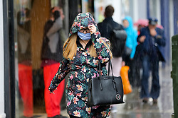 © Licensed to London News Pictures. 17/05/2021. London, UK. A woman is caught in the heavy rain in north London. More rain is forecast for the South East of England this week. Photo credit: Dinendra Haria/LNP