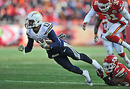 KANSAS CITY, MO - NOVEMBER 24:  Wide receiver Keenan Allen #13 of the San Diego Chargers gets tripped up after catching a pass by safety Quintin Demps #35 of the Kansas City Chiefs during the first half on November 24, 2013 at Arrowhead Stadium in Kansas City, Missouri.  San Diego won 41-38. (Photo by Peter Aiken/Getty Images) *** Local Caption *** Keenan Allen;Quintin Demps