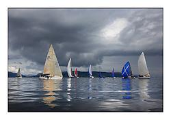 Largs Regatta Week 2011..BEcalmed fleet with a dark clouds