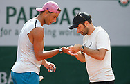 Rafael Nadal of Spain and his fitness coach Rafael Maymo during practice ahead of the French Open 2021, a Grand Slam tennis tournament at Roland-Garros stadium on May 29, 2021 in Paris, France - Photo Jean Catuffe / ProSportsImages / DPPI