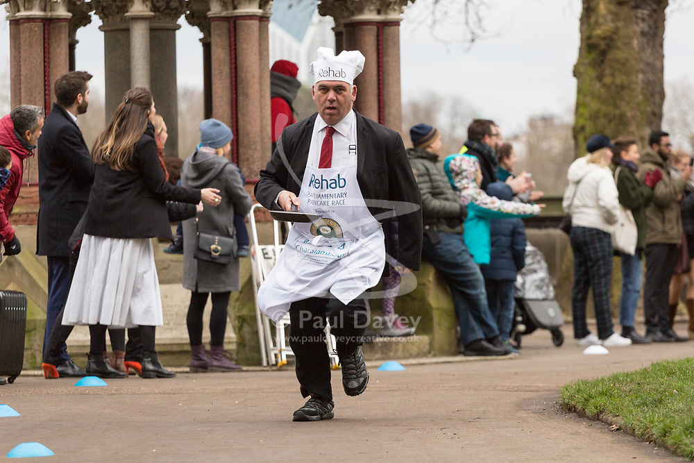 MPs and members of the House of Lords compete in the annual Rehab pancake race, a relay of eleven laps in Victoria Tower Gardens adjacent to the Houses of Parliament in London. The race is held every year on Shrove Tuesday and was won by the Media team. PICTURED: Bambo Charalambous MP. London, February 13 2018.