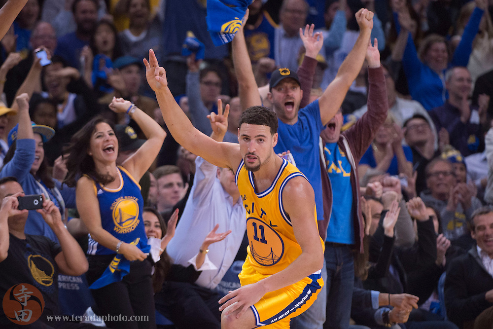 November 17, 2015; Oakland, CA, USA; Golden State Warriors guard Klay Thompson (11) celebrates after making a three-point basket during the second quarter against the Toronto Raptors at Oracle Arena.