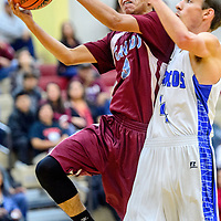 Ganado Hornet Ronnie Ramone (3) pushes to the basket for a layup on the Mancos Bluejays during the Rehoboth Invitational basketball tournament championship game at Rehoboth High School Saturday.