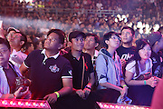 """Fans watch aghast as fighters battle it out in the cage<br /><br />MMA. Mixed Martial Arts """"Tigers of Asia"""" cage fighting competition. Top professional male and female fighters from across Asia, Russia, Australia, Malaysia, Japan and the Philippines come together to fight. This tournament takes place in front of a ten thousand strong crowd of supporters in Pelaing Stadium. Kuala Lumpur, Malaysia. October 2015"""
