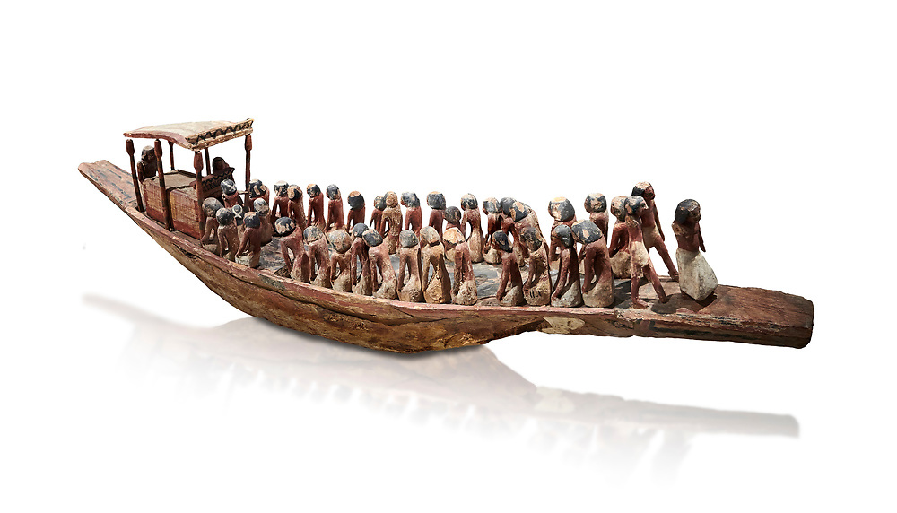 Ancient Egyptian model of a funerary boat with oarsman and a sarcopagus under a canope, Middle Kingdom (1980-1700 BC. Egyptian Museum, Turin. Cat 1209. white background.<br /> <br /> Funerary boats were probably believed to carry the deceased sould to the afterlife. Wooden tomb models were an Egyptian funerary custom throughout the Middle Kingdom in which wooden figurines and sets were constructed to be placed in the tombs of Egyptian royalty. .<br /> <br /> If you prefer to buy from our ALAMY PHOTO LIBRARY  Collection visit : https://www.alamy.com/portfolio/paul-williams-funkystock/ancient-egyptian-art-artefacts.html  . Type -   Turin   - into the LOWER SEARCH WITHIN GALLERY box. Refine search by adding background colour, subject etc<br /> <br /> Visit our ANCIENT WORLD PHOTO COLLECTIONS for more photos to download or buy as wall art prints https://funkystock.photoshelter.com/gallery-collection/Ancient-World-Art-Antiquities-Historic-Sites-Pictures-Images-of/C00006u26yqSkDOM