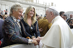 Rockstar Rod Stewart and his wife, Penny Lancaster receive a greeting from pope Francis in St. Peter's square at the end of the weekly general audience on May 23, 2018 in Vatican City. The 73-year-old wore a floral shirt and clashing jacket as he and Penny, 47, joined a weekly general audience with the head of Catholic Church. Photo by ABACAPRESS.COM