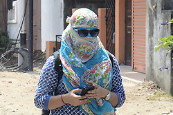 June 7, 2017 - Kolkata, West Bengal, India - Women cover him with scarf to avoid heat wave on hot sunny afternoon in Kolkata. West Bengal along with Central and North Western plains are still under intense heat wave conditions, temperature are likely to reach 39C on June 07, 2017 in Kolkata. (Credit Image: © Saikat Paul/Pacific Press via ZUMA Wire)