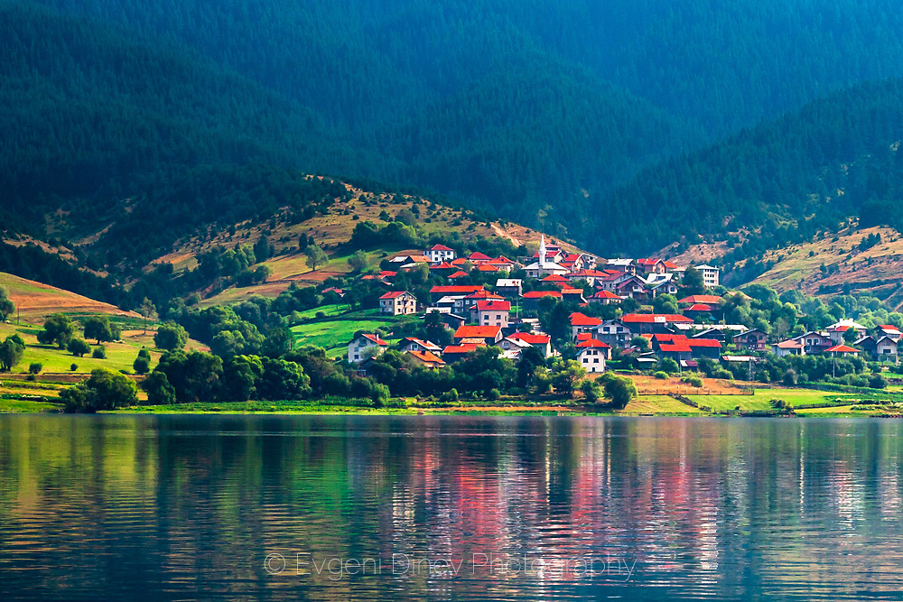 Village of Sarnitsa located by the coast of a lake