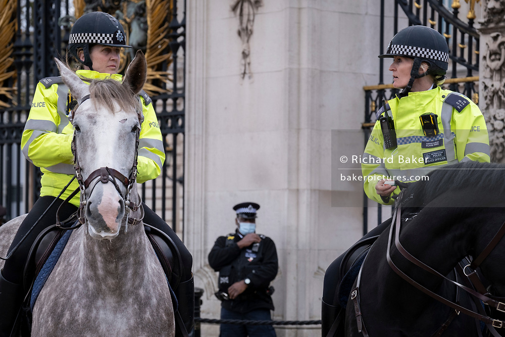 Following the official announcement of the death at age 99 of Prince Phillip, the Duke of Edinburgh, consort to Queen Elizabeth II, mounted police are positioned outside Buckingham Palace, on 9th April 2021, in London, Emgland.