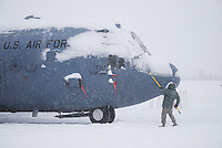 C-130 Hercules being brushed off after winter snowstrom