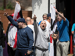 © Licensed to London News Pictures . 03/06/2017 . Liverpool , UK . EDL supporters chanting . Hundreds of police manage a demonstration by the far-right street protest movement , the English Defence League ( EDL ) and an demonstration by opposing anti-fascists , including Unite Against Fascism ( UAF ) . Photo credit: Joel Goodman/LNP