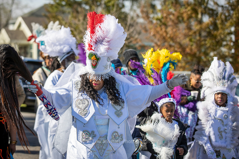 Cherice Harrison-Nelson, Big Queen of the Guardians of the Flame Mardi Gras Indians, leads the Young Guardians of the Flame and the Congo Kids as they parade on Mardi Gras day in the New Orleans Bunny Friend neighborhood.