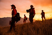HEALDSBURG, CA - OCTOBER 26: A crew of inmate firefighters make their way to firefighting operations to battle the Kincade Fire in Healdsburg, California on October 26, 2019.