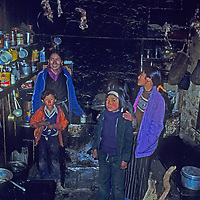 Namdu Sherpani laughs with her children in their kitchen in Namche Bazaar, the leading Sherpa town in Nepal's Himalaya.
